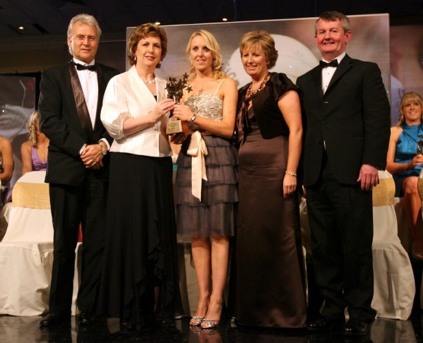 Nollaig Cleary receives her award from Tony Towell, President Mary McAleese, Geraldine Giles and Pol O'Gallchoir
