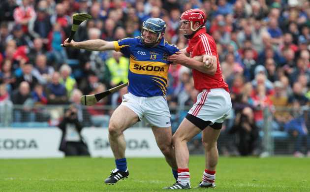 Eoin Kelly is tackled by Brian Murphy
