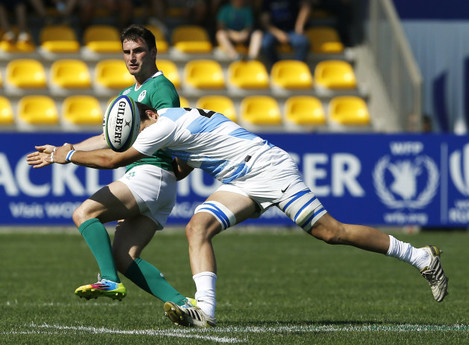 Billy Dardis tackled by Ignacio Calles