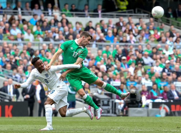 Robbie Brady with Raheem Sterling
