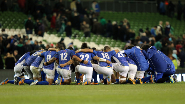 The Samoa team form a huddle after the game