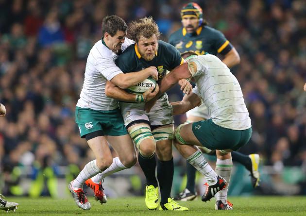 Jonathan Sexton and Rhys Ruddock tackle Duane Vermeulen