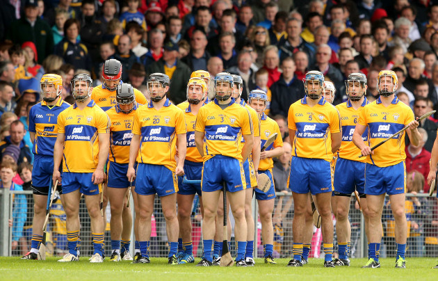 Clare players standing together for the national anthem