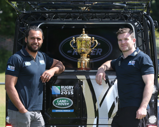 Gordon D'Arcy and Isa Nacewa pose with the Rugby World Cup 2015 Defender as it brings the Webb Ellis Cup to Old Belvedere RFC as part of the Rugby World Cup Trophy Tour_1