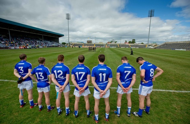 Laois and Antrim players stand for minutes silence for the victims of the Berkley tragedy