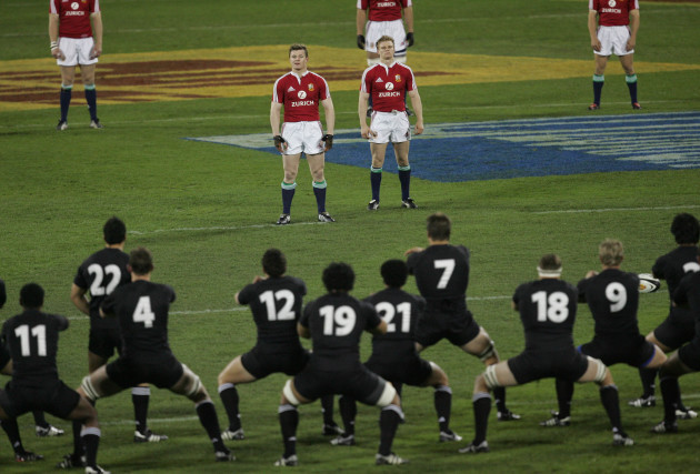 Brian O'Driscoll and Dwayen Peel watch as the Haka is preformed
