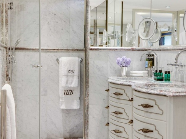 the-suite-bathroom-features-a-shower-sink-and-more-than-enough-mirrors
