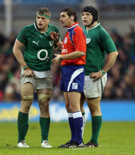 Jamie Heaslip and Mike Ross speak with referee Jerome Garces
