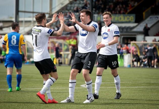 Brian Gartland celebrates scoring with Darren Meenan