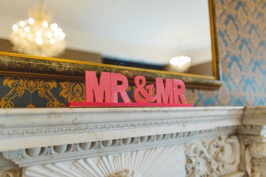 mr-and-mr-sign-Vince-and-Georges-pink-wedding-Berkshire-photographed-by-gay-wedding-photographer-Benjamin-Stuart-Photography-525x350