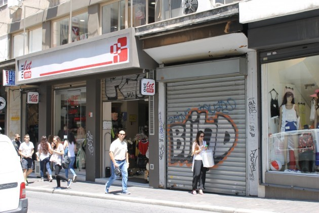 there-was-clearly-more-activity-farther-up-the-road-but-some-stores-were-still-shuttered