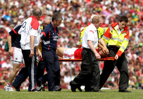 Ciaran Sheehan leaves the field with an injury