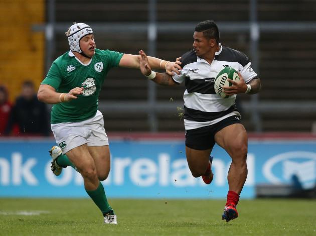 Barbarians David Smith  is tackled by IrelandÕs Luke Marshall