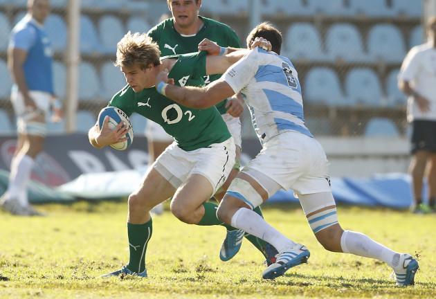 Andrew Trimble is tackled by Antonio Ahualli de Chazal