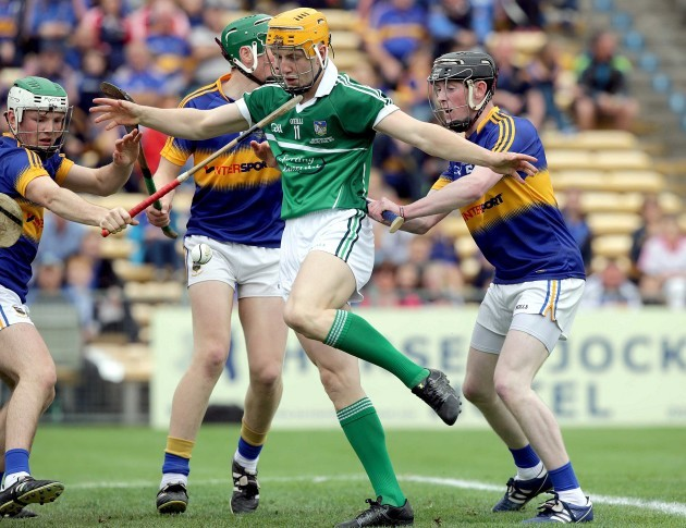 Seamus Flanagan loses his hurl and attempts to kick the sliotar into the back of the net