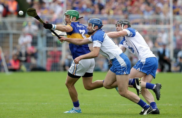James Barry put under pressure by Michael Walsh and Kevin Moran