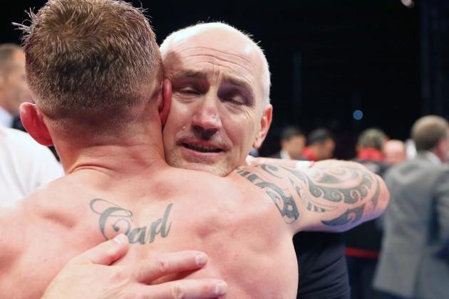 Carl Frampton celebrates winning with Barry McGuigan