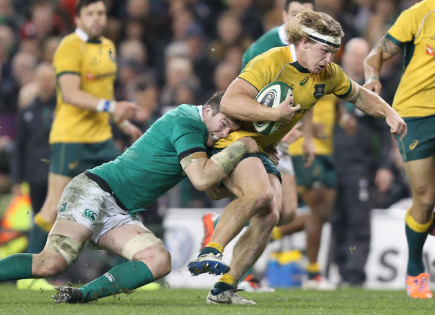 Michael Hooper is tackled by Peter O'Mahony