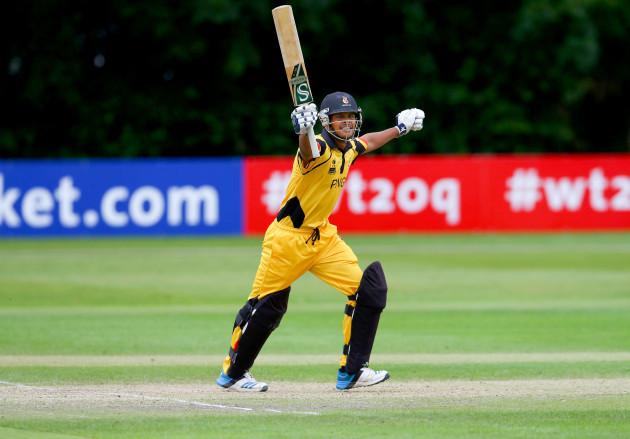 Norman Vanua celebrates hitting a six and winning the match