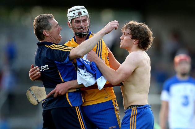 Conor Cleary celebrates at the final whistle with joint manager Donal Moloney and Shane OÕDonnell