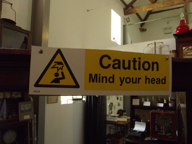 Apothecary Hall - National Botanic Garden of Wales - sign - Caution Mind your head