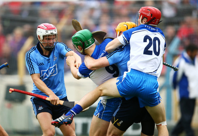 Dublin and Waterford players clash during the final moments of the match