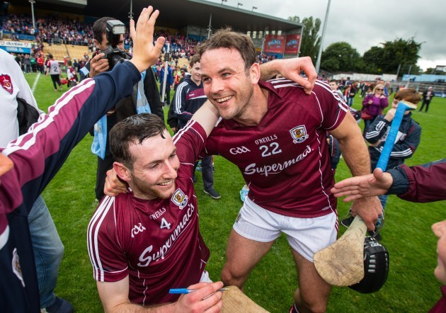 Padraig Mannion and David Collins celebrate after the game