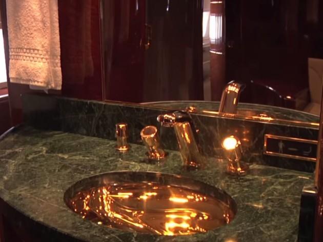 -a-master-bath-with-24-karat-gold-fixtures-and-