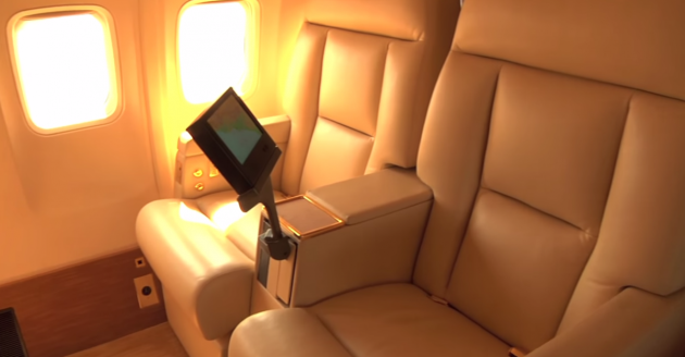 the-seats-have-personal-entertainment-systems-they-convert-into-beds