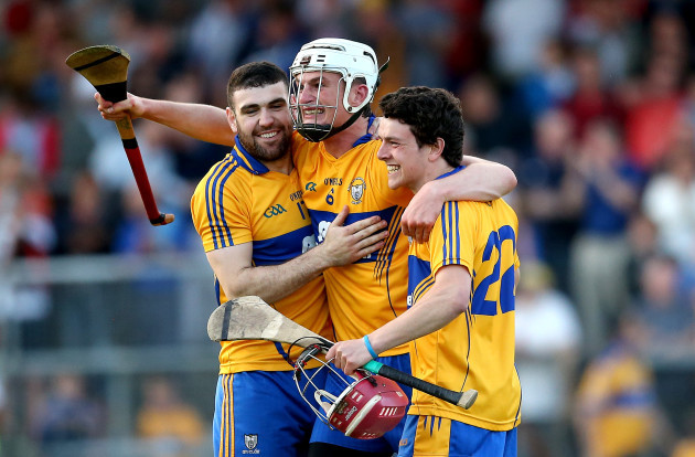 Conor Cleary celebrates at the final whistle with Brian Carey and Diarmuid Moloney