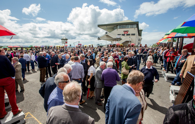 A view of racegoers in the parade ring