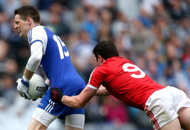 Conor McManus is dragged down by Sean Cavanagh