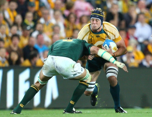 Mark Chisholm tackled by Victor Matfield