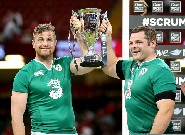 Jamie Heaslip and Mike Ross lift the trophy