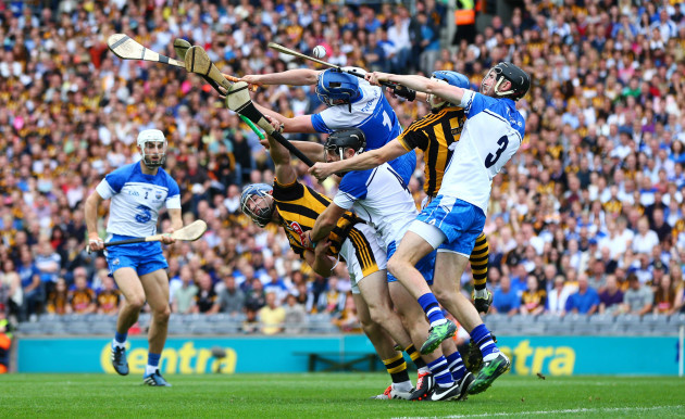 Kilkenny and Waterford players battle for possession