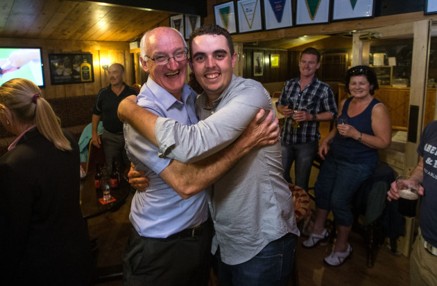 Alan Lowry (Shane Brother) celebrates Esker Hills owner Ray Molloy