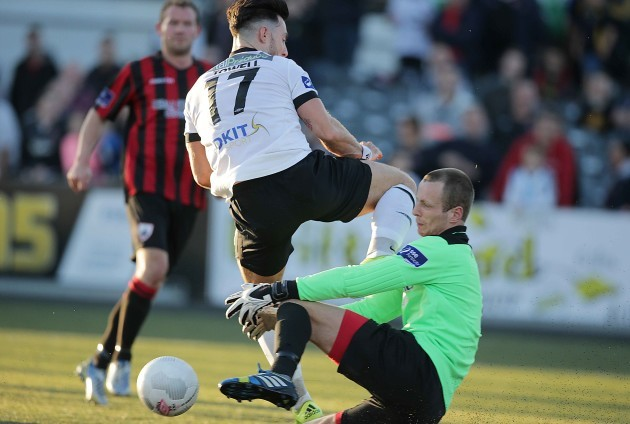 Longford's Paul Hunt makes another save from Dundalk's Richie Towell