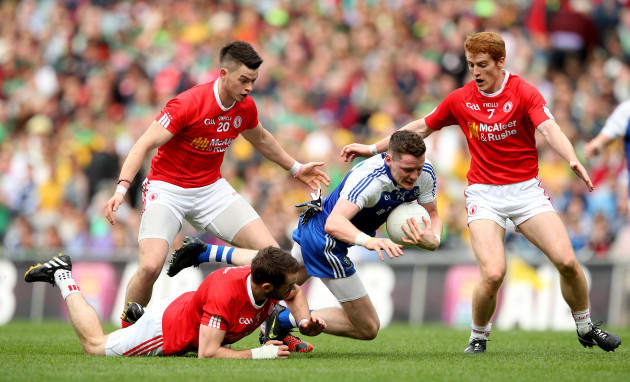 Richie Donnelly, Ronan McNamee and Peter Harte tackle Conor McManus