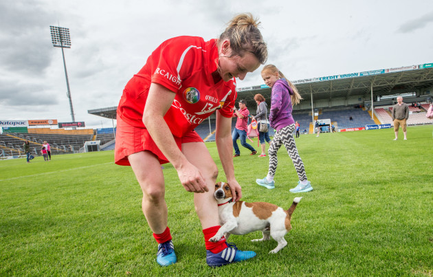 Briege Corkery dog Hernandez greets her after the game