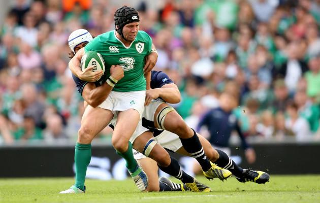 Blair Cowan and Ross Ford tackle Isaac Boss