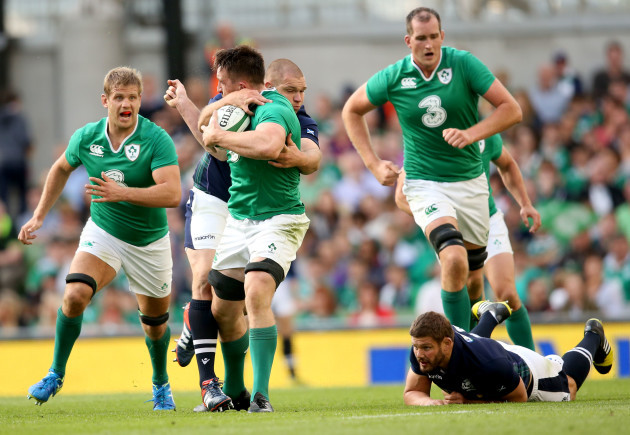 Jack Conan supported by Chris Henry and Devin Toner tackled by Gordon Reid