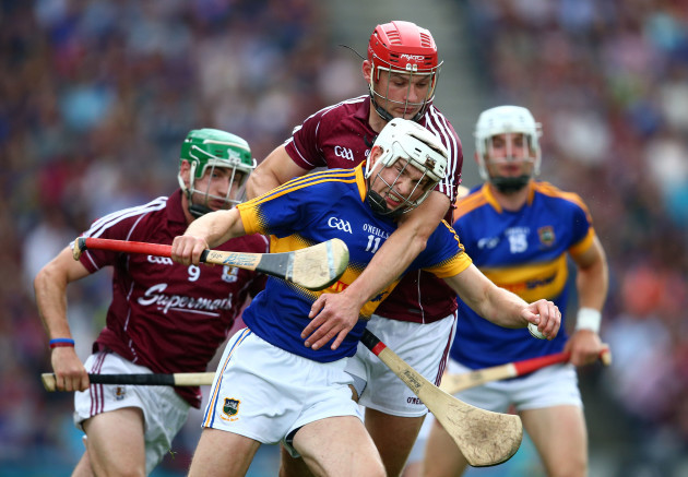 Brendan Maher is tackled by Iarla Tannian