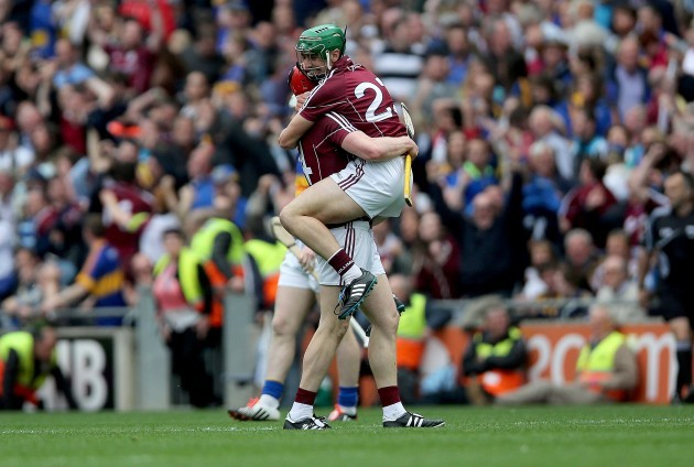 Joe Canning and winning point scorer Shane Moloney celebrate at the final whistle