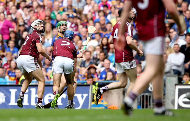Noel McGrath watches as he scores a point