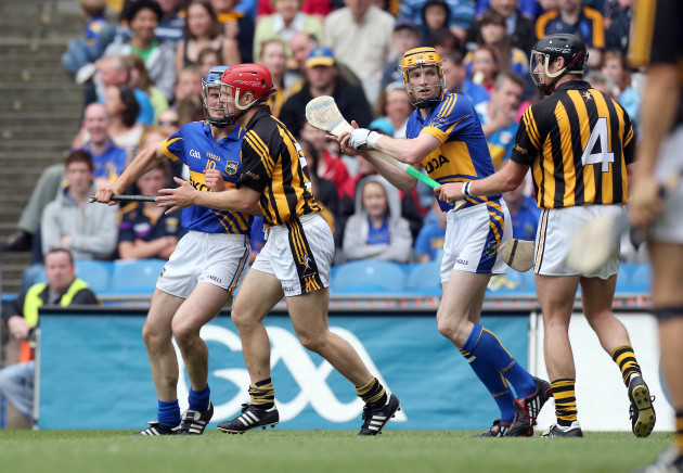 Lar Corbett and Pa Bourke chase around after Tommy Walsh and Jackie Tyrell in the corner of the canal and Cusack Stand while the ball is at the far end of the pitch