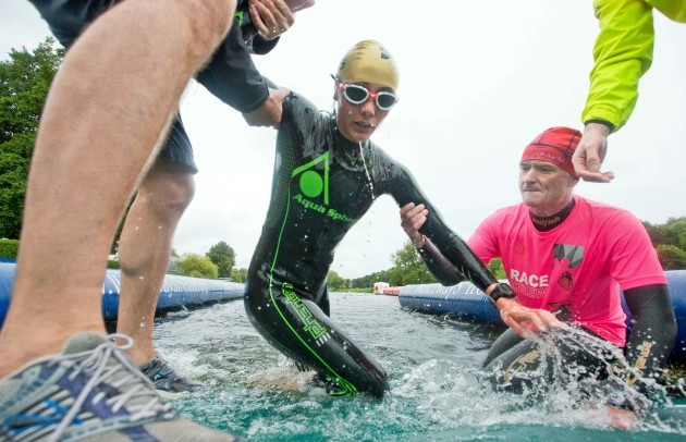 Competitors get a helping hand as they exit the swim section