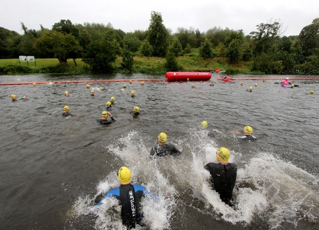 Competitors enter the Liffey