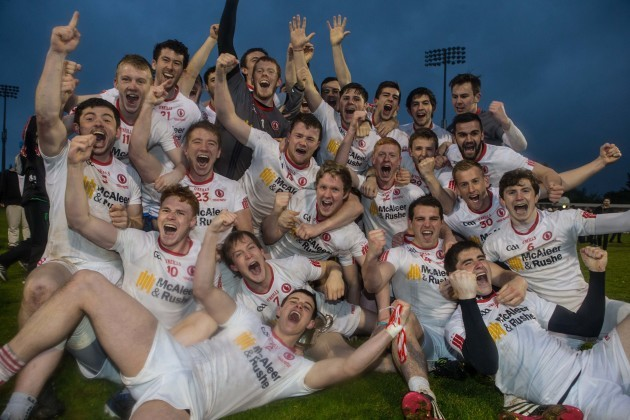 Tyrone players celebrate with the cup