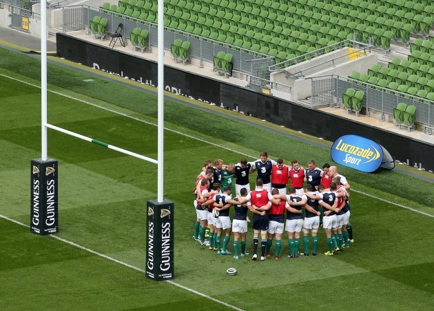 The Ireland players in a team huddle