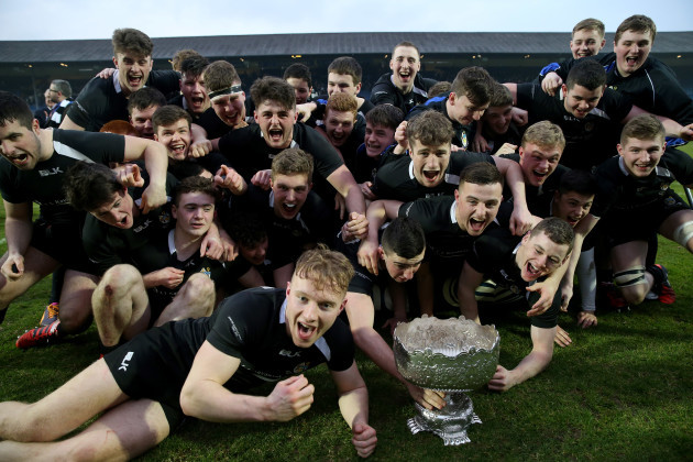 The Roscrea players celebrate with the cup
